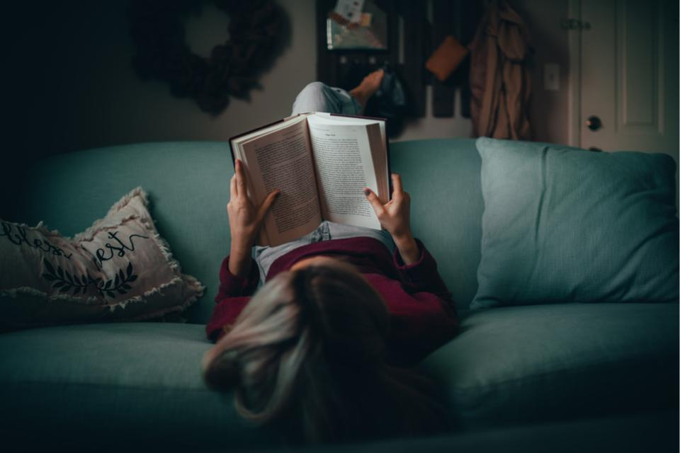 Girl relaxing and reading a book